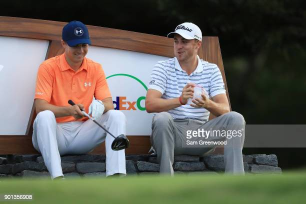 Jordan Spieth of the United States and Justin Thomas of the United States talk on the 18th tee during the first round of the Sentry Tournament of...