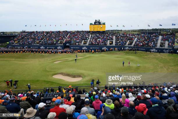 Jordan Spieth of the United States and Matt Kuchar of the United States on the 18th green during the final round of the 146th Open Championship at...