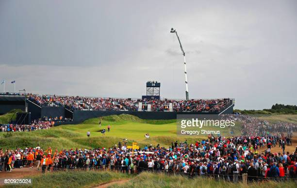 Jordan Spieth of the United States and Matt Kuchar of the United States walk to the 14th green during the third round of the 146th Open Championship...