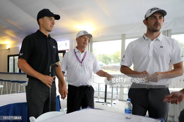 Jordan Spieth of the United States and Patrick Cantlay of the United States wait out a rain delay in a hospitality tent near the third hole during a...