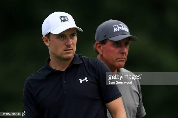 Jordan Spieth of the United States and Phil Mickelson of the United States look on from the 18th tee during the first round of the Workday Charity...