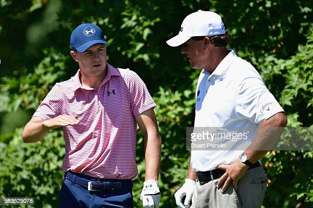 Jordan Spieth of the United States and Phil Mickelson of the United States wait to play during a practice round prior to the 2016 PGA Championship at...