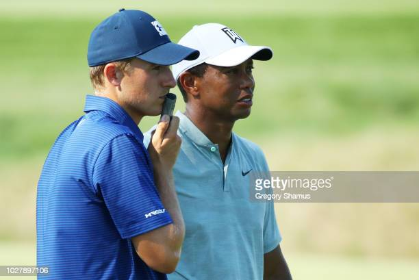 Jordan Spieth of the United States and Tiger Woods of the United States look on during the first round of the BMW Championship at Aronimink Golf Club...
