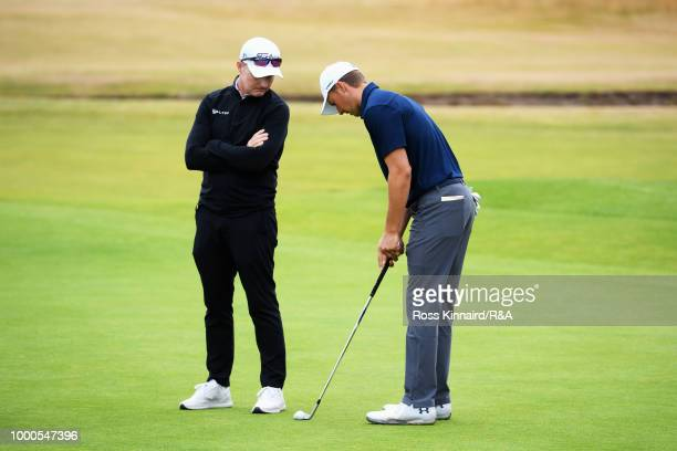 Jordan Spieth of the United States at the 18th hole green with a lofted club while practicing during previews to the 147th Open Championship at...