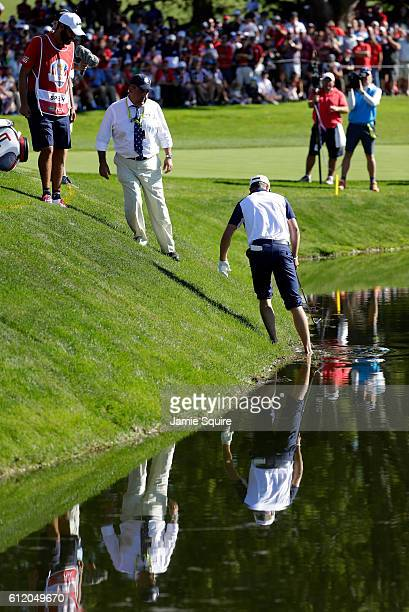Jordan Spieth of the United States attempts a stance over his ball on the 17th hole during singles matches of the 2016 Ryder Cup at Hazeltine...