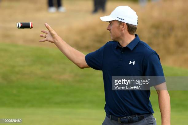 Jordan Spieth of the United States catches his laser rangefinder at the 14th hole green while practicing during previews to the 147th Open...