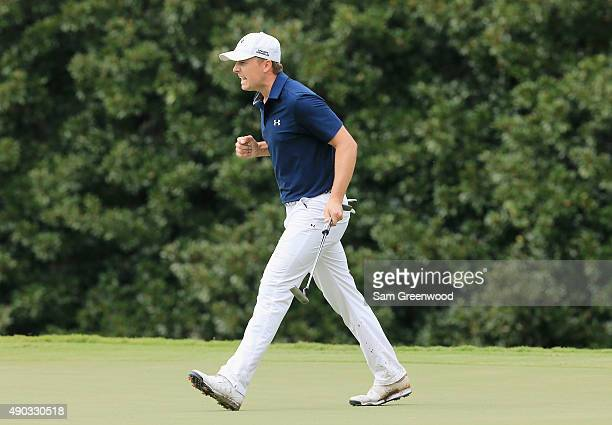 Jordan Spieth of the United States celebrates a long birdie putt on the 11th green during the final round of the TOUR Championship By CocaCola at...