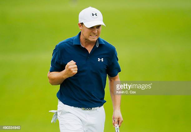 Jordan Spieth of the United States celebrates a par save on the 16th green during the final round of the TOUR Championship By CocaCola at East Lake...