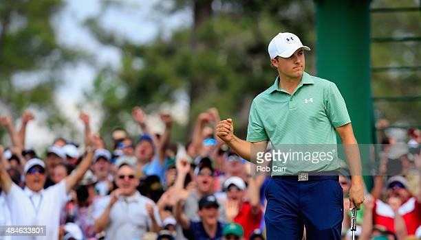 Jordan Spieth of the United States celebrates after a birdie putt on the seventh green during the final round of the 2014 Masters Tournament at...