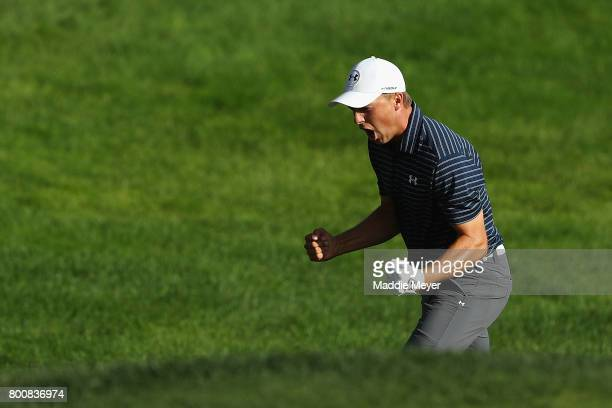 Jordan Spieth of the United States celebrates after chipping in for birdie from a bunker on the 18th green to win the Travelers Championship in a...