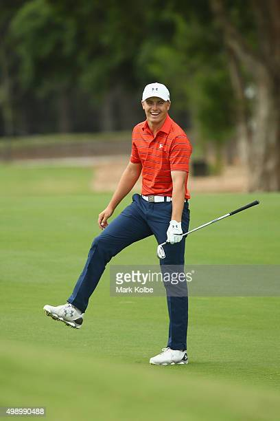 Jordan Spieth of the United States celebrates after holing his approach shot for an eagle on the 17th hole during day three of the 2015 Australian...
