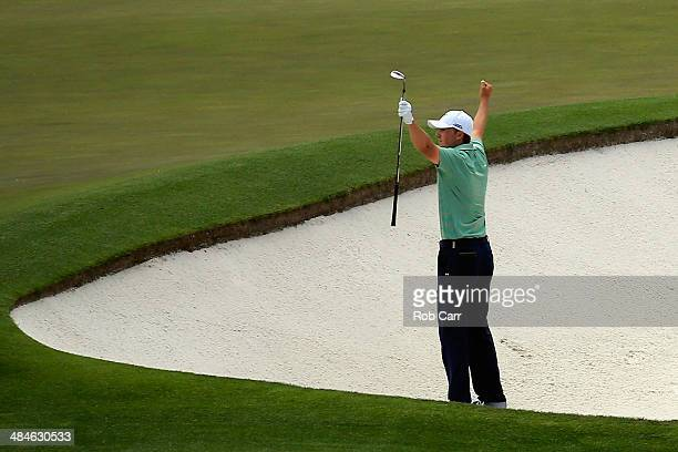 Jordan Spieth of the United States celebrates after holing out for birdie on the fourth hole during the final round of the 2014 Masters Tournament at...