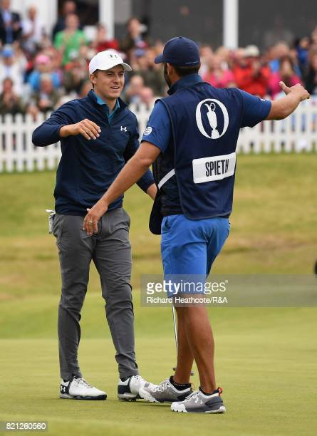 Jordan Spieth of the United States celebrates his victory on the 18th green with caddie Michael Greller during the final round of the 146th Open...