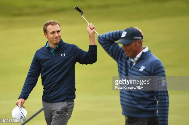 Jordan Spieth of the United States celebrates his victory on the 18th green with a dejected Matt Kuchar of the United States during the final round...