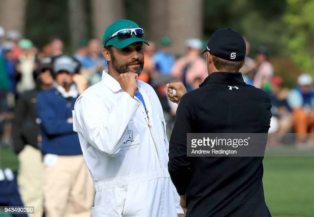 Jordan Spieth of the United States celebrates making birdie on the16th hole with caddie Michael Greller during the final round of the 2018 Masters...