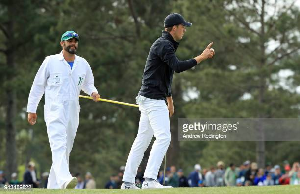Jordan Spieth of the United States celebrates making par on the 17th hole during the final round of the 2018 Masters Tournament at Augusta National...