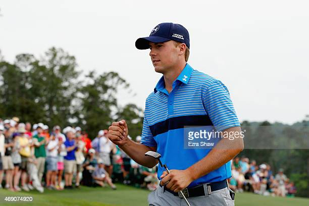 Jordan Spieth of the United States celebrates on the 18th green after an eighthunder par 64 during the first round of the 2015 Masters Tournament at...