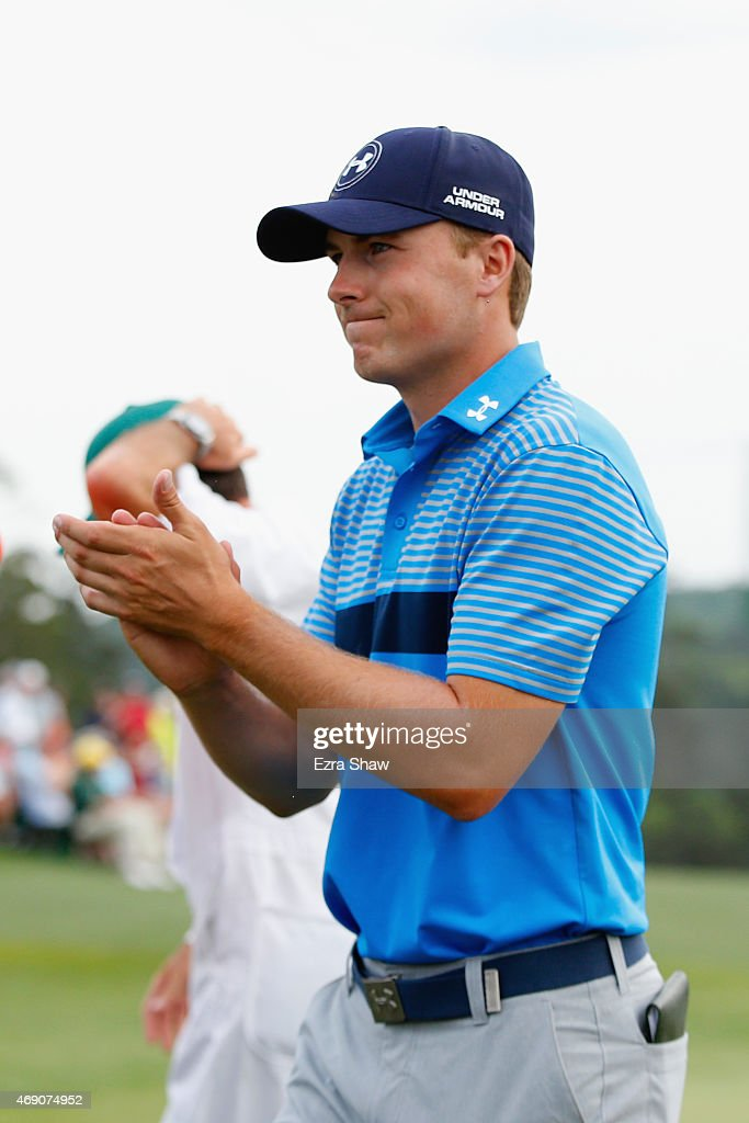 Jordan Spieth of the United States celebrates on the 18th green after an eighth-under par 64 during the first round of the 2015 Masters Tournament at Augusta National Golf Club on April 9, 2015 in Augusta, Georgia.