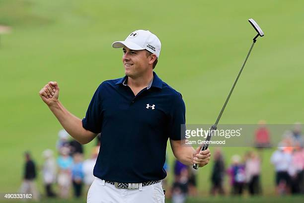 Jordan Spieth of the United States celebrates on the 18th green after his fourstroke victory at the TOUR Championship By CocaCola on his way to also...