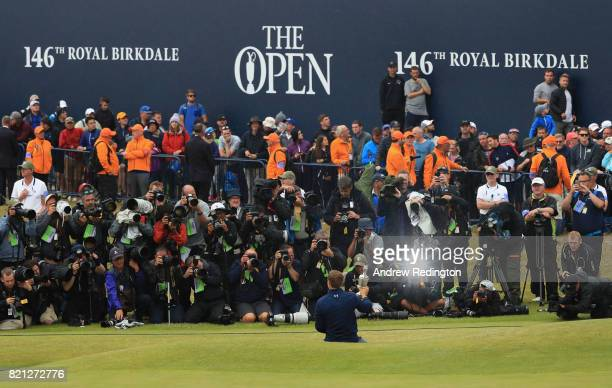 Jordan Spieth of the United States celebrates victory as he poses in front of photographers with the Claret Jug on the 18th green during the final...