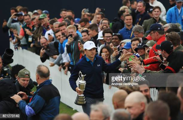 Jordan Spieth of the United States celebrates victory as he walks with the Claret Jug around the 18th green during the final round of the 146th Open...