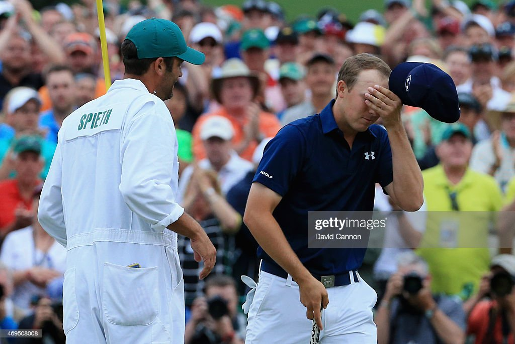 Jordan Spieth of the United States celebrates with his caddie Michael Greller on the 18th green after his four-stroke victory at the 2015 Masters Tournament at Augusta National Golf Club on April 12, 2015 in Augusta, Georgia.