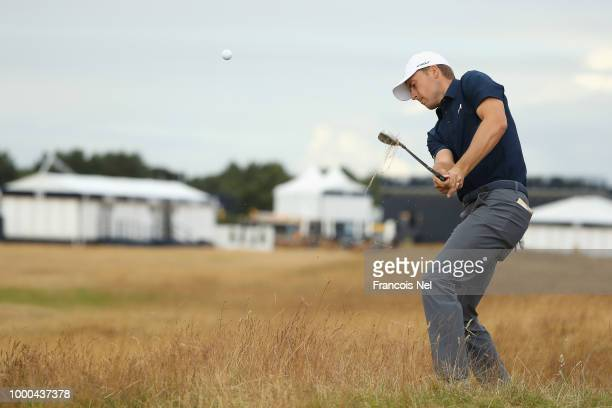 Jordan Spieth of the United States chips from the rough during previews to the 147th Open Championship at Carnoustie Golf Club on July 17 2018 in...