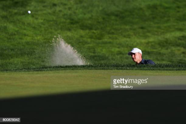 Jordan Spieth of the United States chips in for birdie from a bunker on the 18th green to win the Travelers Championship in a playoff against Daniel...