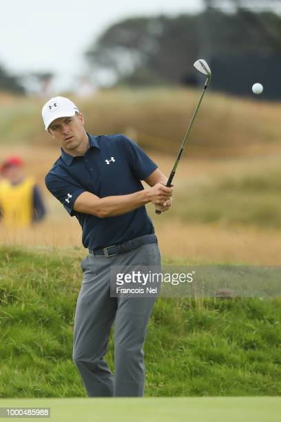 Jordan Spieth of the United States chips on the 16th hole during previews to the 147th Open Championship at Carnoustie Golf Club on July 17 2018 in...