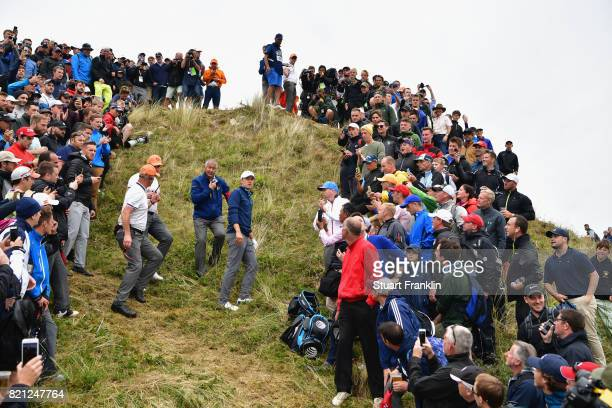 Jordan Spieth of the United States considers his options with Rules Officials on the 13th hole during the final round of the 146th Open Championship...