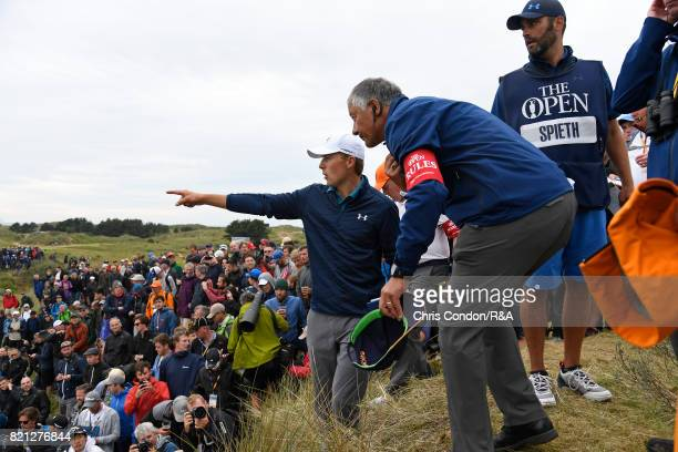 Jordan Spieth of the United States considers his options with Rules Officials on the 13th hole during the final round of the the 146th Open...