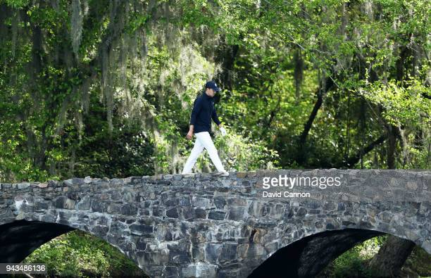 Jordan Spieth of the United States crosses the Nelson Bridge on the 13th hole during the final round of the 2018 Masters Tournament at Augusta...