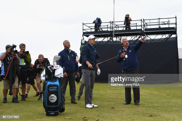 Jordan Spieth of the United States discusses a penalty drop on the practise range while playing the 13th hole with referee John Parramore during the...