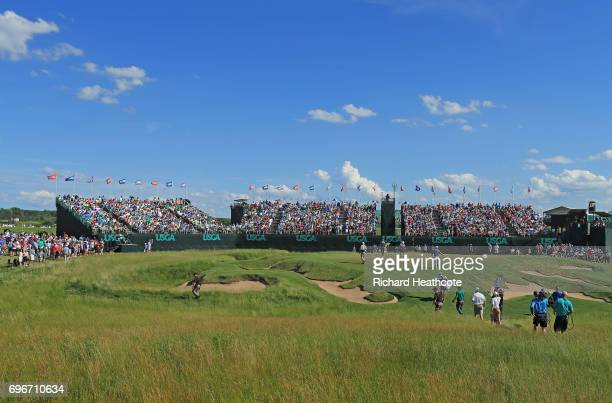 Jordan Spieth of the United States, Dustin Johnson of the United States, and Martin Kaymer of Germany walk to the ninth green during the second round...