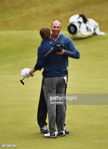Jordan Spieth of the United States embraces Matt Kuchar of the United States after victory on the 18th green during the final round of the 146th Open...