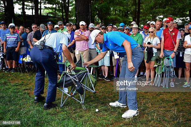 Jordan Spieth of the United States evaluates his ball on the 18th hole as fans look on during the second round of the 2016 PGA Championship at...