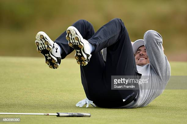 Jordan Spieth of the United States falls over laughing as he plays a practice round ahead of the 144th Open Championship at The Old Course on July 13...