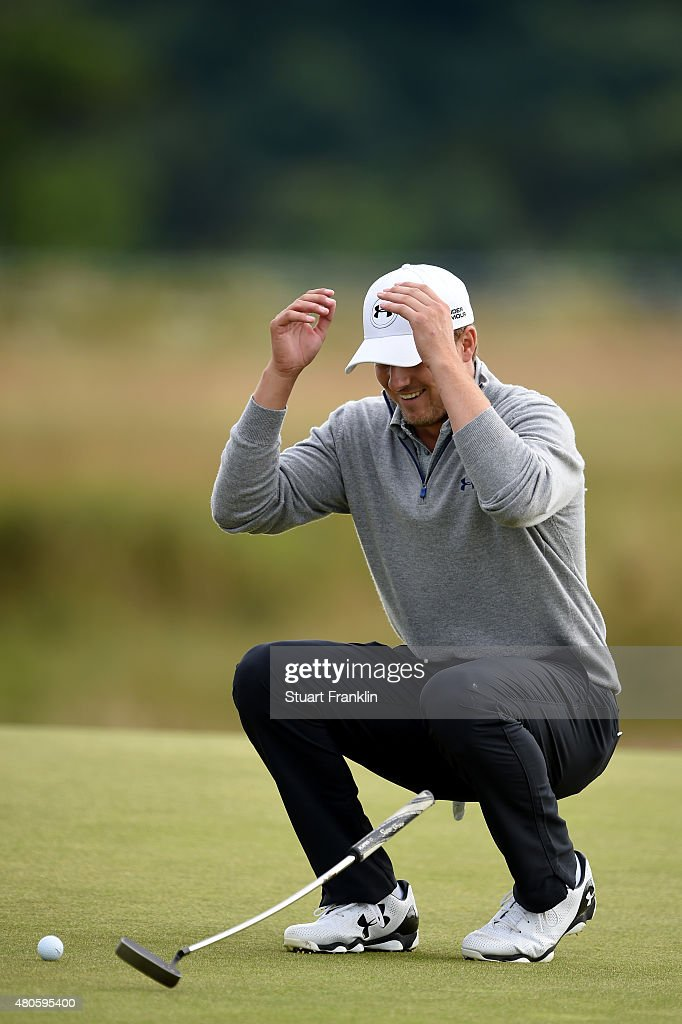 Jordan Spieth of the United States falls over laughing as he plays a practice round ahead of the 144th Open Championship at The Old Course on July 13, 2015 in St Andrews, Scotland.