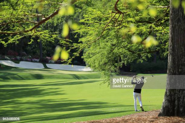 Jordan Spieth of the United States follows his second shot on the 13th hole during the final round of the 2018 Masters Tournament at Augusta National...