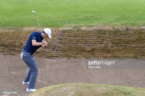 Jordan Spieth of the United States hits a bunker shot on the 18th hole during previews to the 147th Open Championship at Carnoustie Golf Club on July...