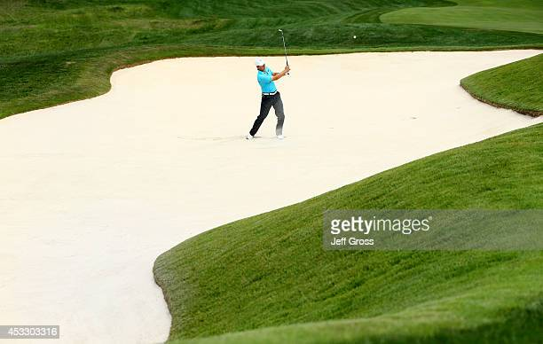 Jordan Spieth of the United States hits a shot from a bunker on the ninth hole during the first round of the 96th PGA Championship at Valhalla Golf...