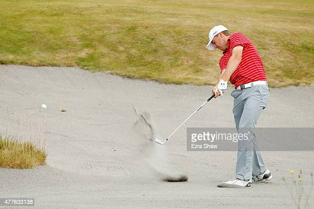 Jordan Spieth of the United States hits a shot from a bunker on the fifth hole during the first round of the 115th U.S. Open Championship at Chambers...