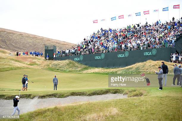 Jordan Spieth of the United States hits a shot from a greenside bunker during a practice round prior to the start of the 115th US Open Championship...