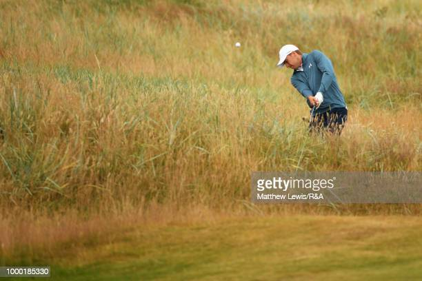 Jordan Spieth of the United States hits from the rough during previews to the 147th Open Championship at Carnoustie Golf Club on July 16 2018 in...