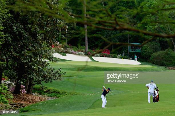 Jordan Spieth of the United States hits his approach on the 13th fairway during the final round of the 2015 Masters Tournament at Augusta National...