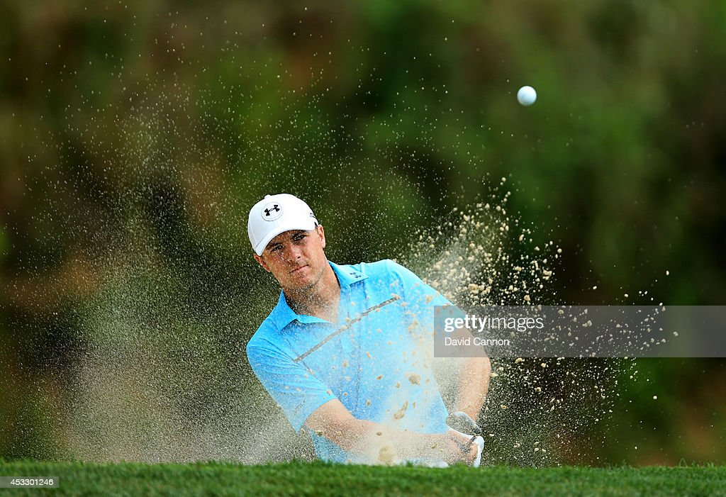 Jordan Spieth of the United States hits his second shot from a greenside bunker on the third hole during the first round of the 96th PGA Championship at Valhalla Golf Club on August 7, 2014 in Louisville, Kentucky.