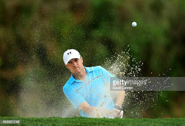 Jordan Spieth of the United States hits his second shot from a greenside bunker on the third hole during the first round of the 96th PGA Championship...