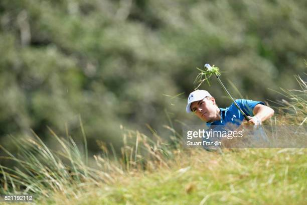 Jordan Spieth of the United States hits his second shot from the rough on the 1st hole during the final round of the 146th Open Championship at Royal...
