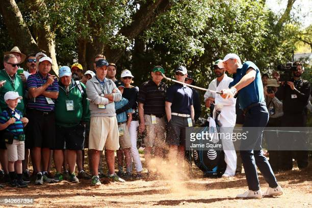 Jordan Spieth of the United States hits his second shot from the pine straw on the first hole during the second round of the 2018 Masters Tournament...