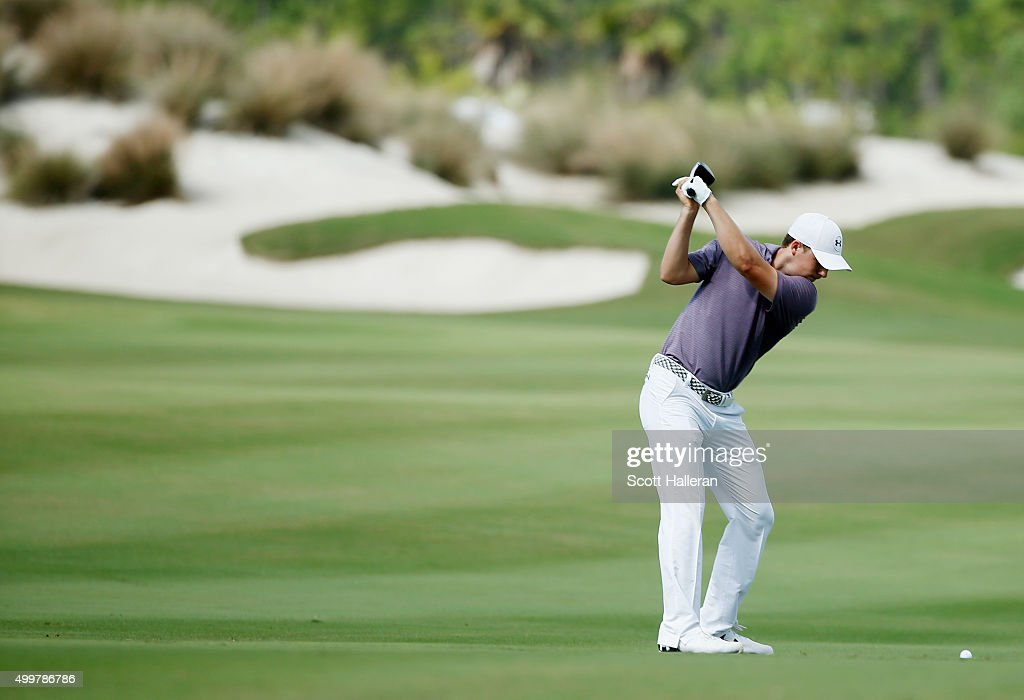 Jordan Spieth of the United States hits his second shot on the third hole during the first round of the Hero World Challenge at Albany, The Bahamas on December 3, 2015 in Nassau, Bahamas